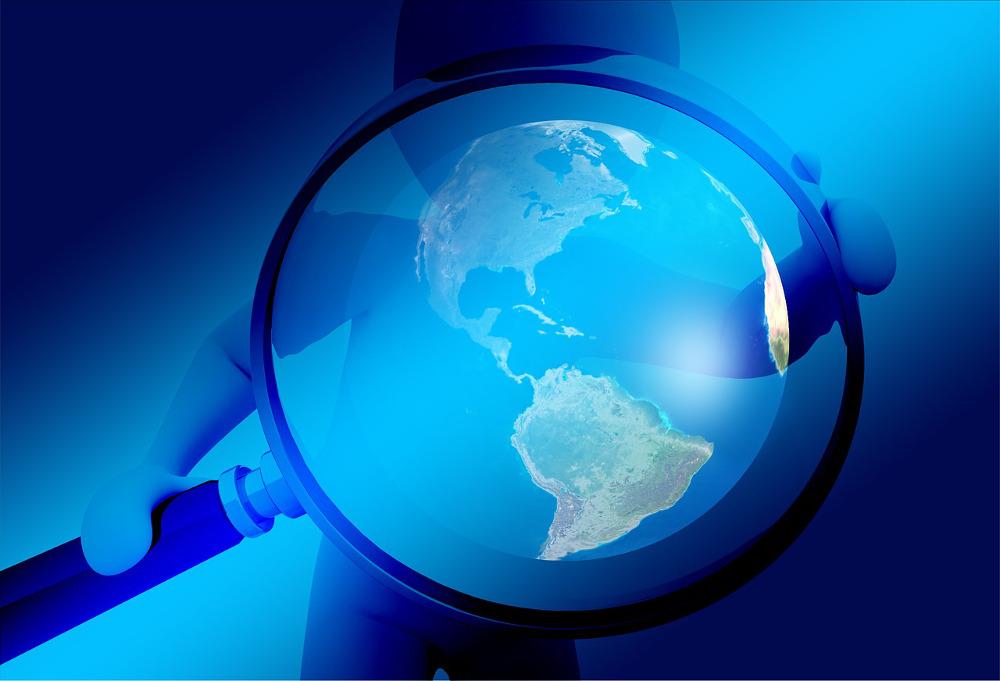 Darstellung einer Lupe über einem Globus zur Illustration von eTutorials zum Thema: Screencasts als eTutorials in der Bibliothek