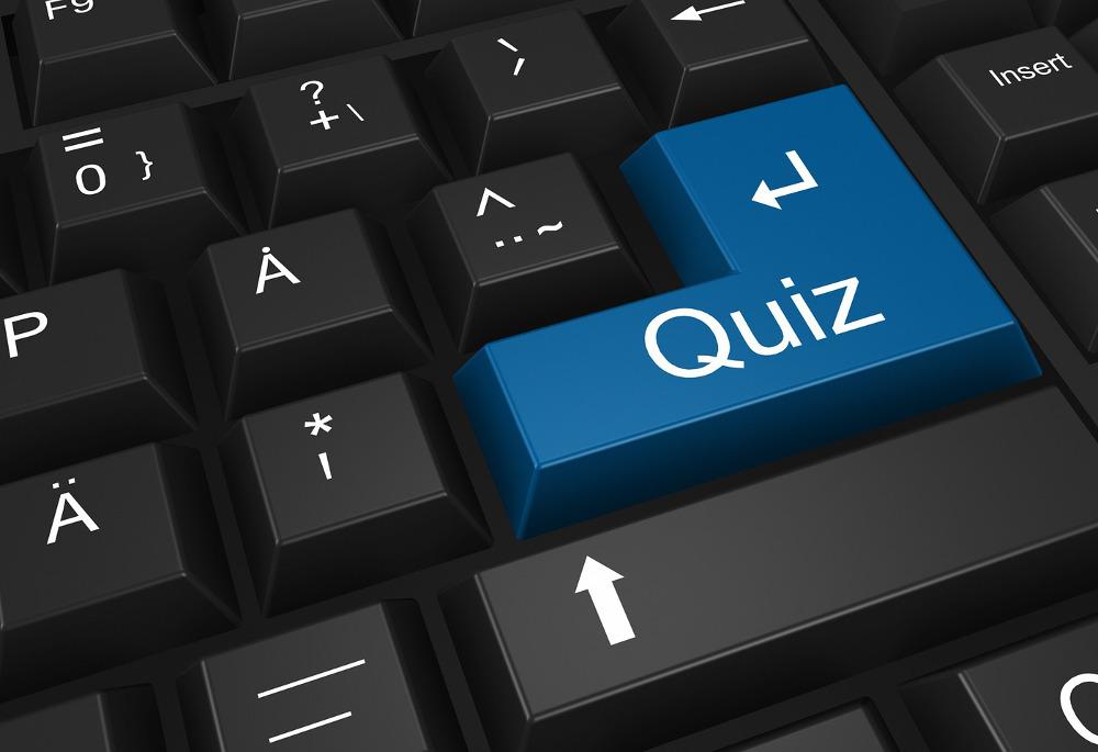 Darstellung einer Tastatur, auf deren Eingabetaste nicht Enter steht, sondern Quiz.